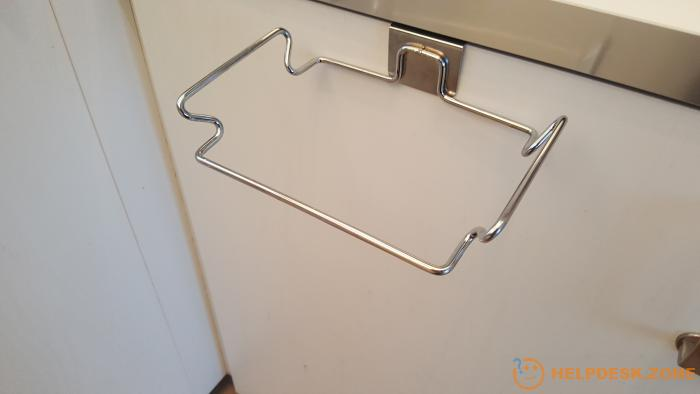 It's extremely simple to mount the holder to the kitchen cupboard